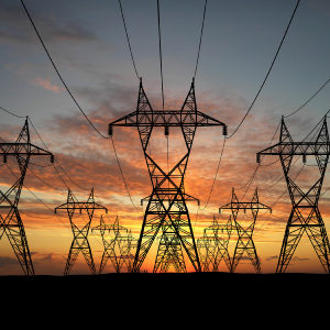 3D Electric powerlines over sunrise
